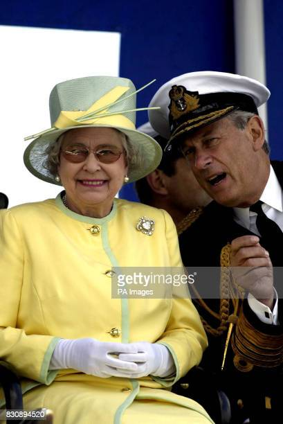 Chief of the Defence Staff Sir Michael Boyce talks with Britain's Queen Elizabeth II on board the aircraft carrier HMS Ark Royal as she watches a...