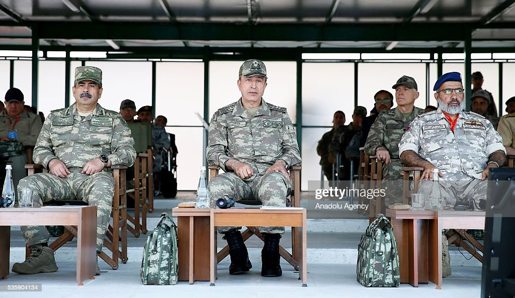 Chief of the General Staff of the Turkish Armed Forces, Hulusi Akar (C) and other commanders are seen during the Efes-2016 Combined Joint Live Fire Exercise at Seferihisar district of Izmir, Turkey on May 30, 2016. The Turkish-led multinational military exercises, Efes-2016 which started at 04 May and will be finished at 04 June 2016, aims to train participating units and staff in planning and conducting combined and joint operations, including logistics and command-control as well as to improve the level of interoperability among headquarters and forces.