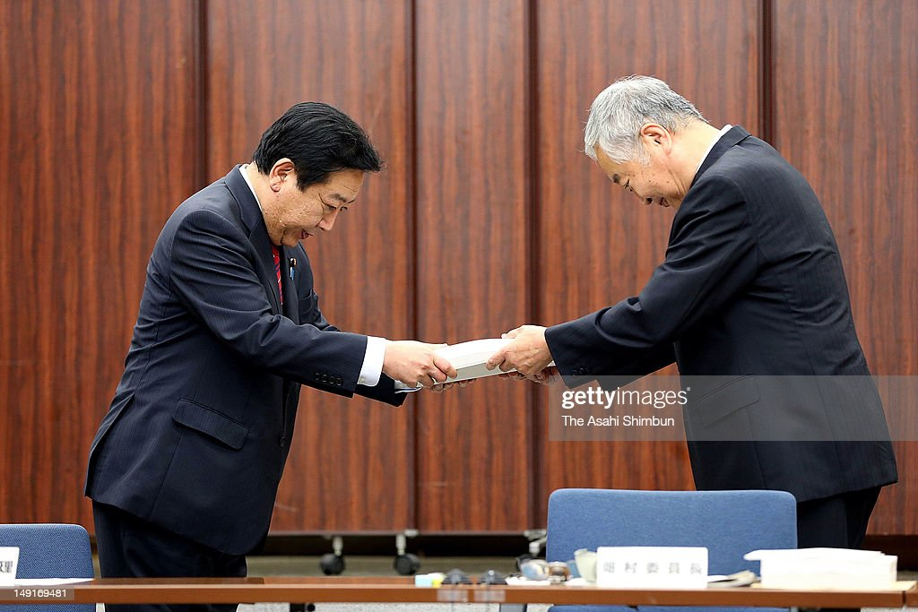 Chief of the government investigation committee on the accident at the Fukushima Daiichi nuclear power plant Yotaro Hatamura (R) hands in the final report to Prime Minister Yoshihiko Noda (L) on July 23, 2012 in Tokyo, Japan. The government panel looking into last year's accident pointed to a lack of a 'safety culture' at both Tokyo Electric Power Co. and the central government.
