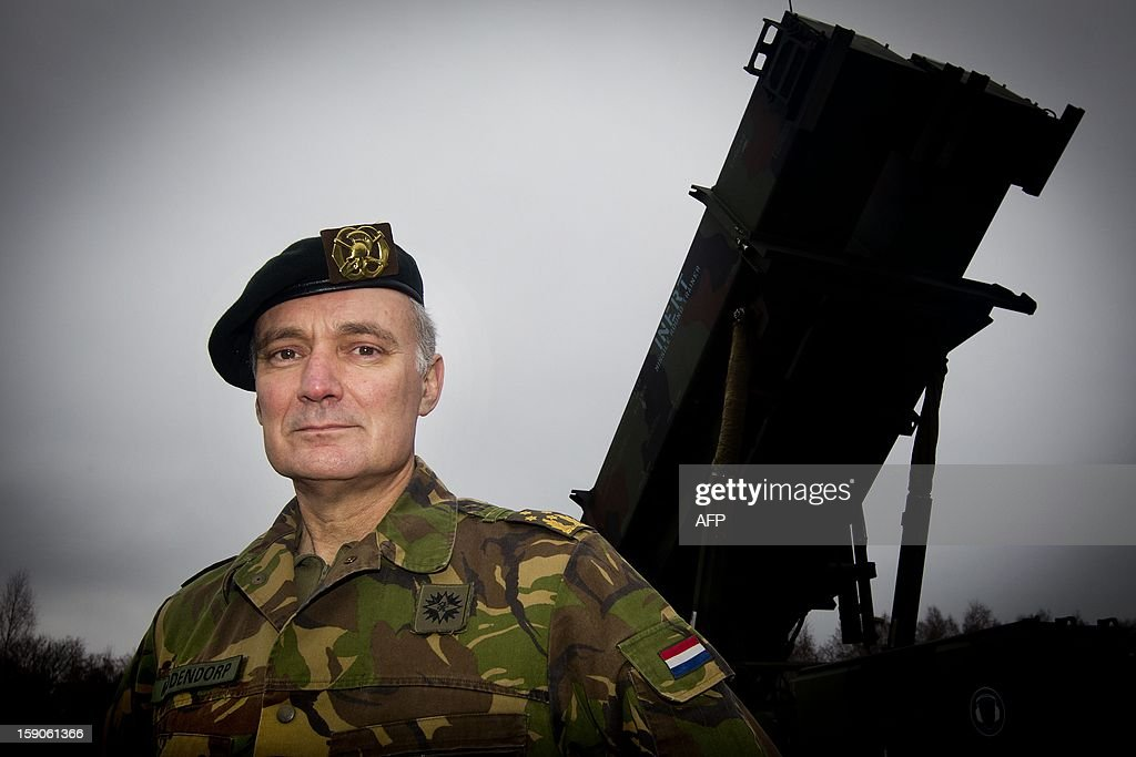 Chief of the Netherlands Defence Staff Tom Middendorp stands in front of a Dutch Patriot defence missile prior to the transportation of the missiles from their base in Vredepeel, The Netherlands, on January 7, 2013, to the Eems harbor in Groningen. The missiles will be shipped to Turkey where they are to be used to protect the country from possible attacks from neighbouring Syria. netherlands out