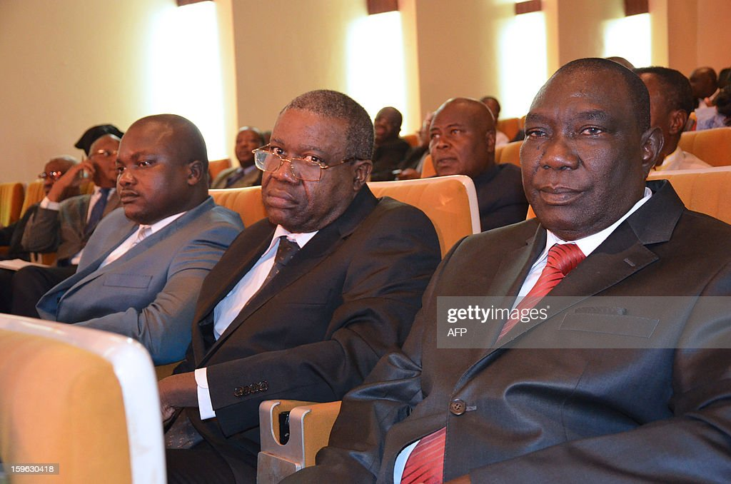 Chief of the SELEKA rebel alliance, Michel Djotodia (R), sits alongside rebel leader Christophe Gazzam Betty (C) and rebel military chief Ali Mahamat (L), on January 17, 2013 in Bangui during a ceremony at which Central Africa's President signed a decree appointing Nicolas Tiangaye as new prime minister. Opposition figure Nicolas Tiangaye was officially appointed today Prime Minister of the Central African Republic's new national unity government, President Francois Bozize said after a ceremony in the capital Bangui. The announcement was in line with a peace deal struck between the ruling party, the Seleka rebels and the democratic opposition in the Gabonese capital of Libreville last week.