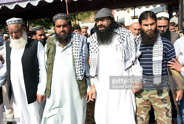 Chief of the United Jihad Council Syed Salahuddin walks with JaisheMohammad chief in Kashmir Mufti Muhammad Asghar and HarkatulMujahideen chief...