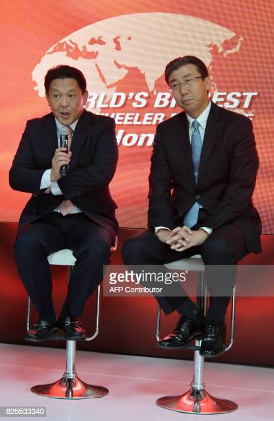 Chief Officer Asia and Oceania Regional Operations Honda Motor Company Ltd Shinji Aoyama addresses a press confrence while President and CEO of Honda...