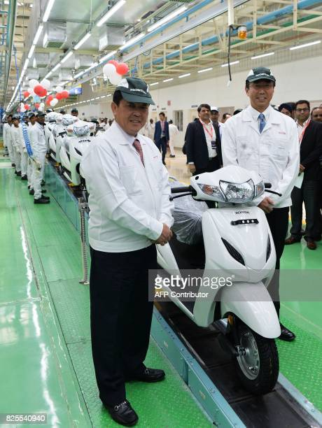 Chief Officer Asia and Oceania Regional Operations Honda Motor Company Ltd Shinji Aoyama and President and CEO of Honda Motorcycle Scooter India Pvt...
