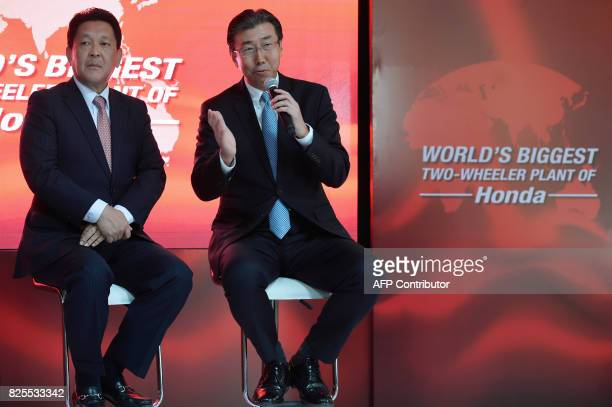 Chief Officer of Asia and Oceania Regional Operations Honda Motor Company Ltd Shinji Aoyama looks on while President and CEO of Honda Motorcycle...
