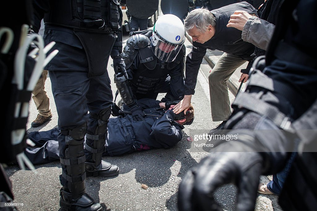 Chief officer of the Brussels police Vandersmissen lies wounded on the ground after he has been hit by a protester. An anti government protest ended up in a riot in Brussels on May 24, 2016.