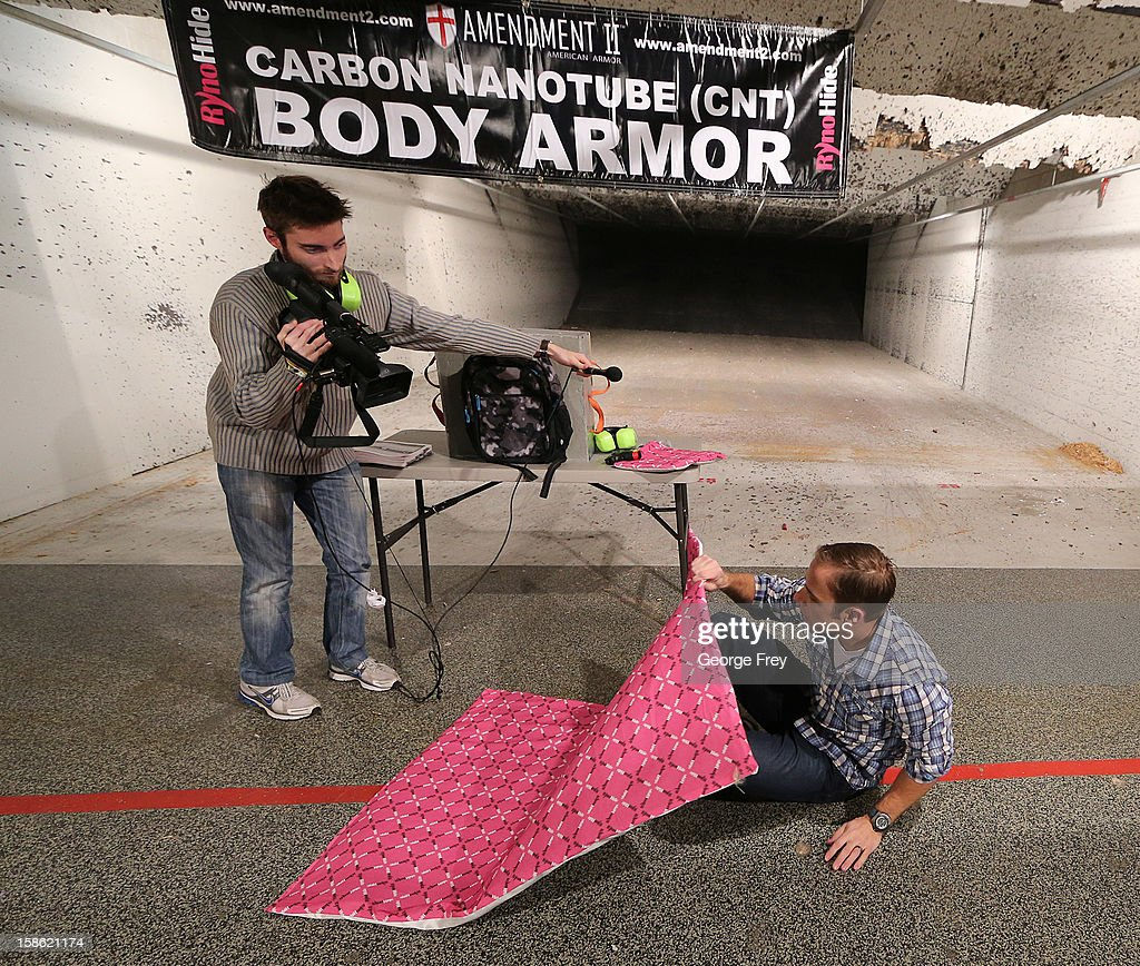 Chief Operating Officer for Amendment II, Rich Brand, demonstrates a Rynohide CNT Blanket Shield on December 21, 2012 in Salt Lake City, Utah. Their orders for the bulletproof shield have gone up dramatically since the school shooting in Connecticut last week.