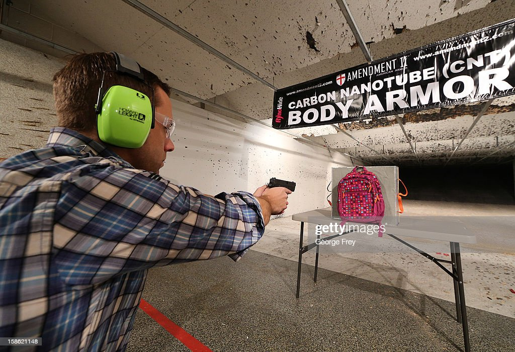 Chief Operating Officer for Amendment II, Rich Brand, shoots a child's backpack with their Rynohide CNT Shield in it on December 21, 2012 in Salt Lake City, Utah. Their orders for the bulletproof shield have gone up dramatically since the school shooting in Connecticut last week.