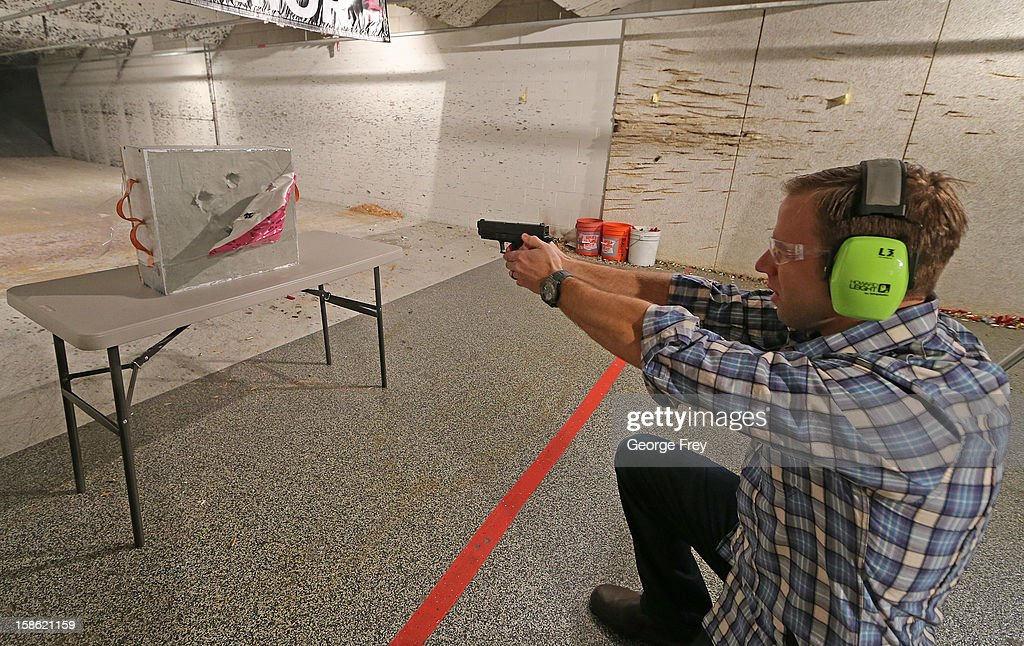 Chief Operating Officer for Amendment II, Rich Brand, shoots at their Rynohide CNT Shield on December 21, 2012 in Salt Lake City, Utah. Their orders for the bulletproof shield have gone up dramatically since the school shooting in Connecticut last week.