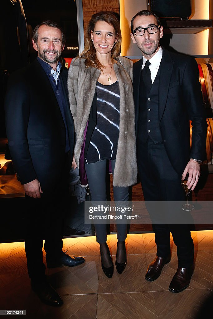 Chief Operating Officer of Paris Saint-Germain Jean-Claude Blanc, his wife Stephanie Blanc and Fashion designer of Berluti, Alessandro Sartori attend Berluti Flagship Store Opening on November 26, 2013 in Paris, France.