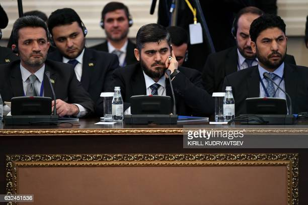 TOPSHOT Chief opposition negotiator Mohammad Alloush of the Jaish alIslam rebel group attends the first session of Syria peace talks at Astana's...
