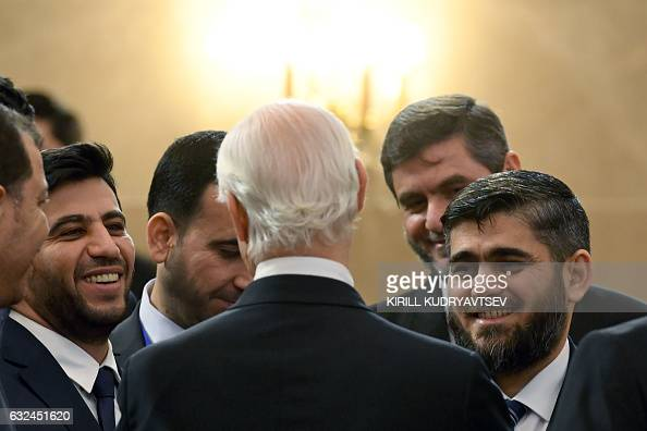 TOPSHOT Chief opposition negotiator Mohammad Alloush of the Jaish alIslam rebel group listens to UN envoy for Syria Staffan de Mistura prior to the...
