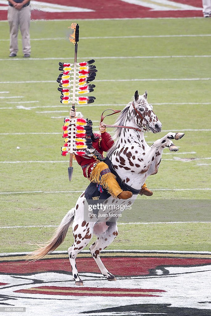 Chief Osceola and Renegade of the Florida State Seminoles plant the spear at mid-field before the game against the Syracuse Orange at Doak Campbell Stadium on Bobby Bowden Field on October 31, 2015 in Tallahassee, Florida. Florida State defeated Syracuse 45 to 21.