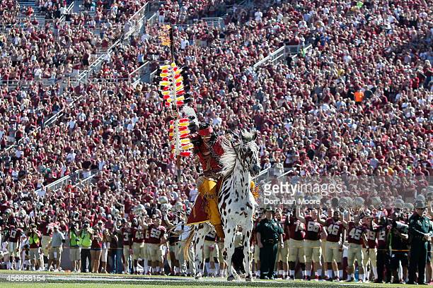 Chief Osceola and Renegade of the Florida State Seminoles plants the spear in the middle of the field before the game against the Wake Forest Demon...