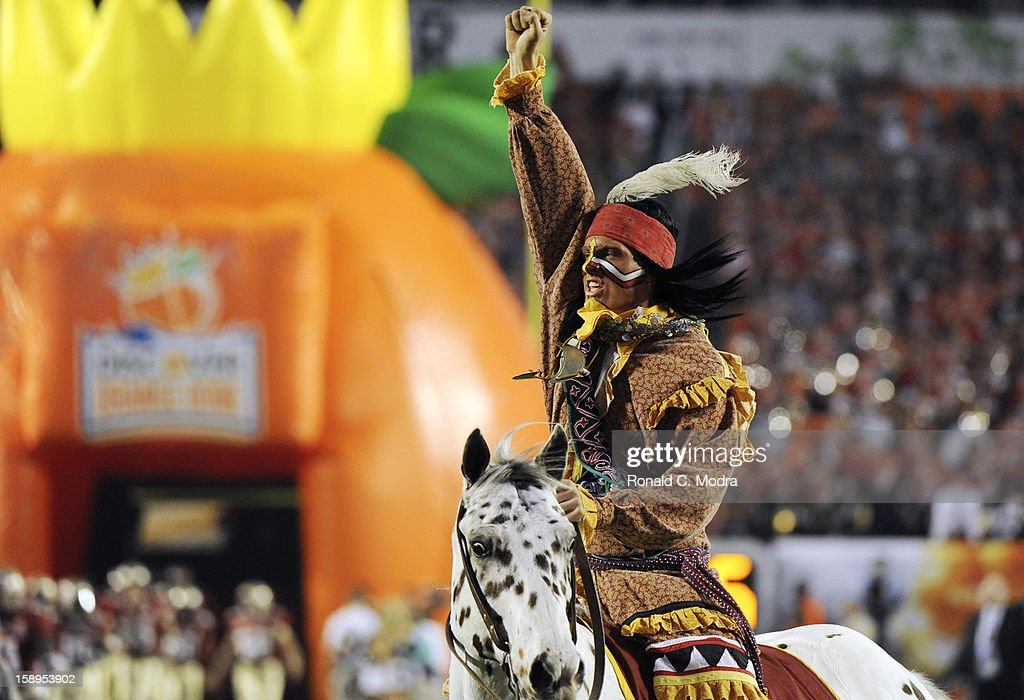 Chief Osceola of the Florida State Seminoles rides Renegade onto the field prior to the game against the Northern Illinois Huskies during the 2013 Discover Orange Bowl at Sun Life Stadium on January 1, 2013 in Miami, Florida.