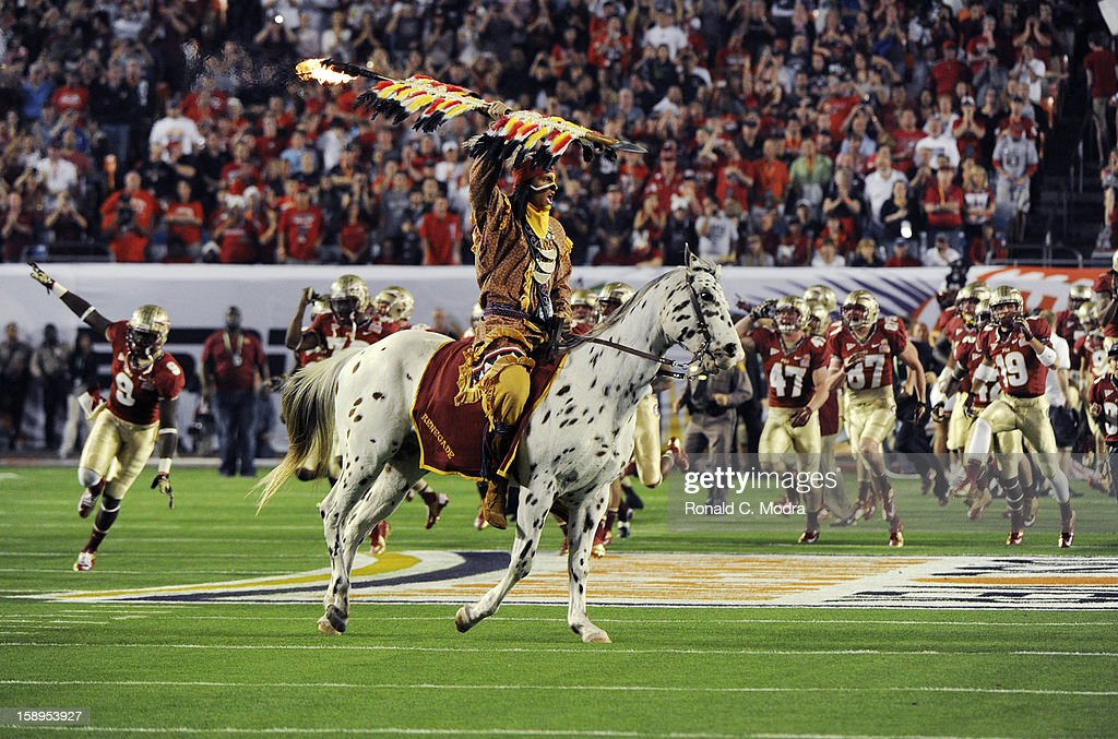 Chief Osceola of the Florida State Seminoles rides Renegade onto the field as the players come out prior to the game against the Northern Illinois Huskies during the 2013 Discover Orange Bowl at Sun Life Stadium on January 1, 2013 in Miami, Florida.