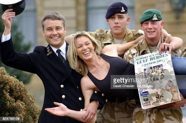 Chief Petty Officer Paul Harrison Nick Coward of the Royal Artillery and Tommy Graham of 2nd Brigade pose with model Nell McAndrew at County Hall in...