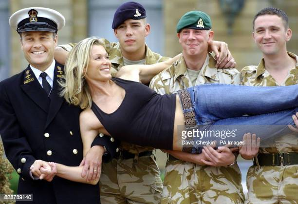 Chief Petty Officer Paul Harrison Nick Coward of the Royal Artillery Tommy Graham of 2nd Brigade and Scott Hunter of 2nd Signals pose with model Nell...