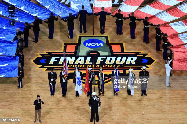 Chief Petty Officer Stephen Powell sings the national anthem before the game between the Gonzaga Bulldogs and the North Carolina Tar Heels during the...