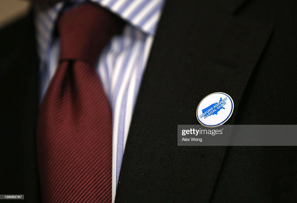 Chief Policy Advisor to New York City Mayor Michael Bloomberg and Chairman of Mayors Against Illegal Guns John Feinblatt wears a pin of his group during a news conference January 16, 2013 on Capitol Hill in Washington, DC. Members of Mayors Against Illegal Guns held a news conference to call on Congress to take action to end gun violence.