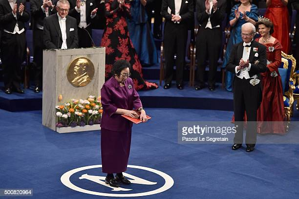 Chief Professor Tu Youyou laureate of the Nobel Prize in Physiology or Medicine acknowledges applause after she received her Nobel Prize from King...