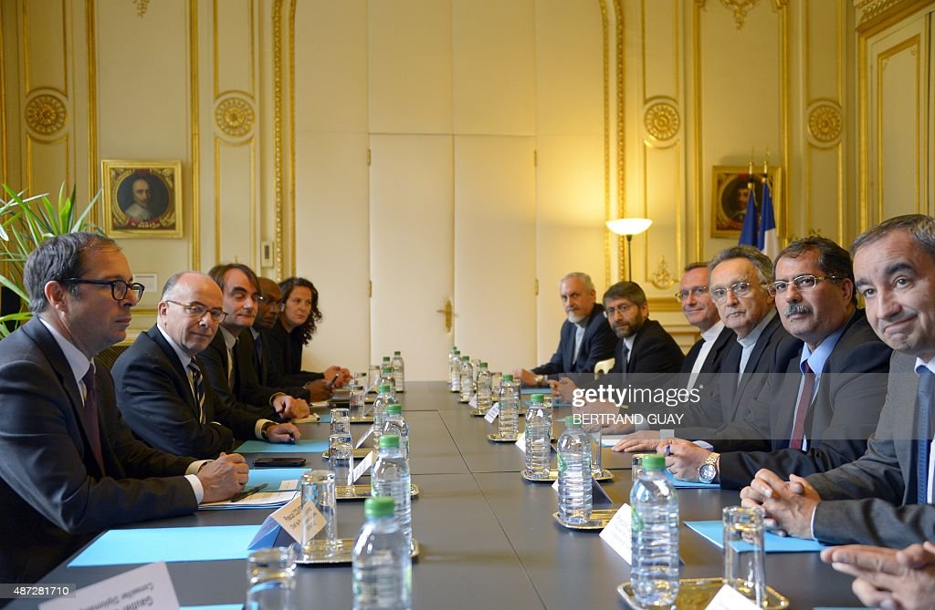 Chief Rabbi of France Haim Korsia sits next to the General Secretary of the Bishops of France Monseigneur Olivier Ribadeau Dumas the President of...