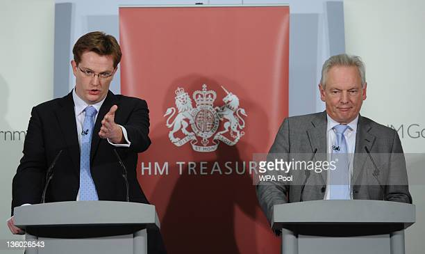 Chief Secretary to the Treasury Danny Alexander and Cabinet Office minister Francis Maude hold a news conference at the Treasury on December 20 2011...