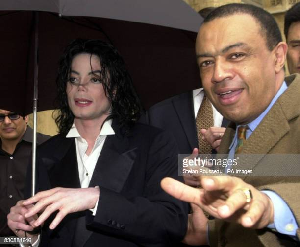 Chief Secretary to the Treasury Paul Boateng gives US singer Michael Jackson a tour of the Houses of Parliment in London Jackson was the guest of...