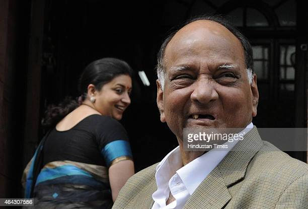 NCP chief Sharad Pawar and HRD Minister Smiriti Irani during Budget session at Parliament house on February 24 2015 in New Delhi India The government...