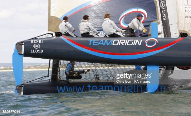 PA Chief Sports Writer Frank Malley sailing alongside triple Olympic gold medallist Sir Ben Ainslie on the Team Origin Extreme 40 catamaran during a...