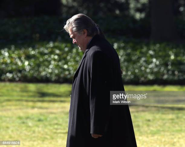 Chief Strategist Steve Bannon walks behind US President Donald Trump toward Marine One before departing from the White House on February 24 2017 in...