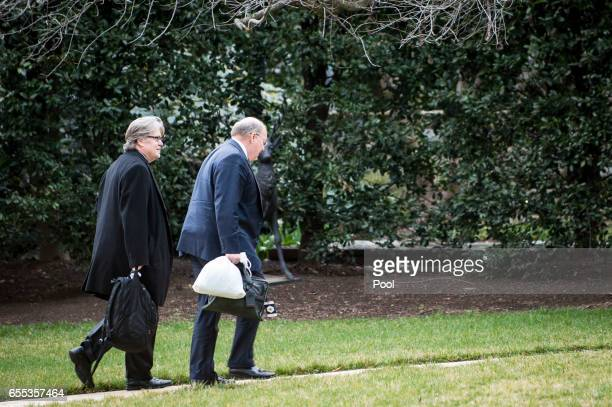 Chief strategist to President Trump Stephen Bannon and Deputy Chief of Staff for Operations Joe Hagin walk to the West Wing after returning to the...