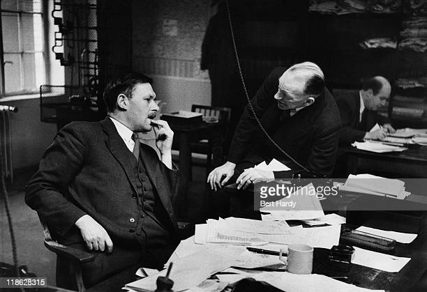 Chief Sub Editor 'Tiny' Lear discussing a problem with the Editor A G Waters at the 'News of The World' office 18th April 1953 Original Publication...