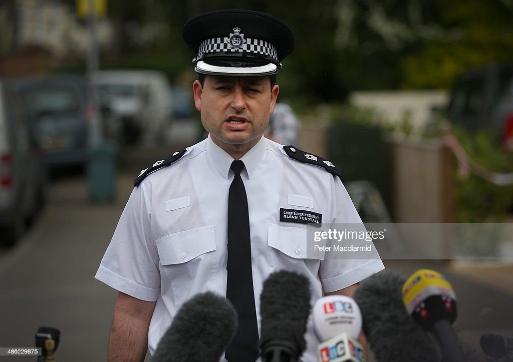 Chief Superintendent Glenn Tunstall talks to reporters at a house in New Malden where the bodies of three children were found on April 23, 2014 in south London, England. Police say that a 43 year old woman has been arrested after the bodies of three children were found at a property last night.