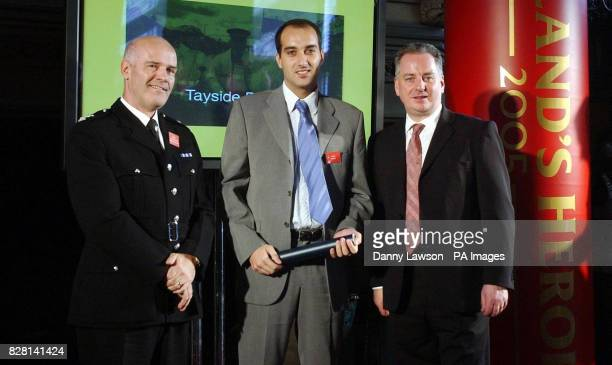 Chief superintendent Matthew Hamilton Jose Luis Chinestra Colom and First Minister Jack McConnell at the Scotland's Heroes Awards presentation...