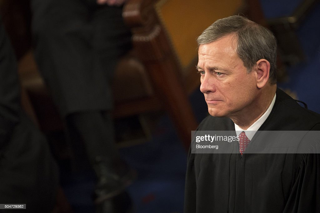 Chief Supreme Court Justice John Roberts listens as US President Barack Obama delivers the State of the Union address to a joint session of Congress...