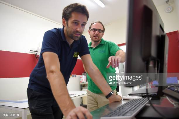 Chief veterinary clinic Baptiste Mulot and veterinary Antoine Leclerc use a scanner at the veterinary clinic at the Zooparc of Beauval on June 23 in...