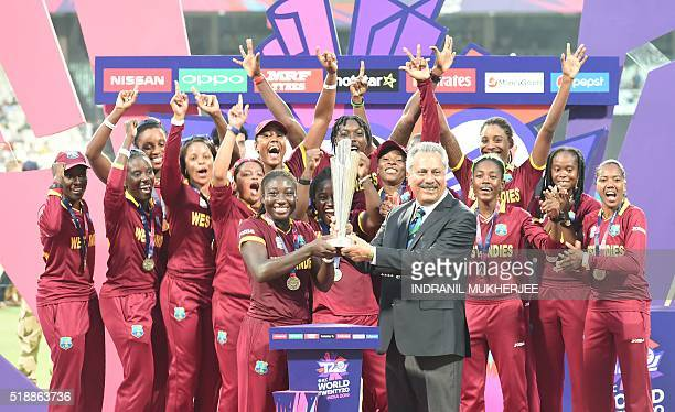 ICC Chief Zaheer Abbas presents the trophy to West Indies's Stafanie Taylor after West Indies won the World T20 cricket tournament women's final...