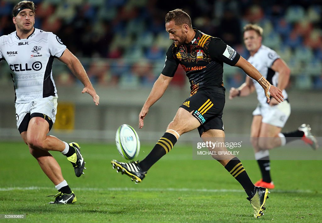Chiefs' Aaron Cruden kiks the ball forward during the Super Rugby match between the Waikato Chiefs of New Zealand and Coastal Sharks of South Africa at Yarrow Stadium in New Plymouth on April 29, 2016 / AFP / MICHAEL