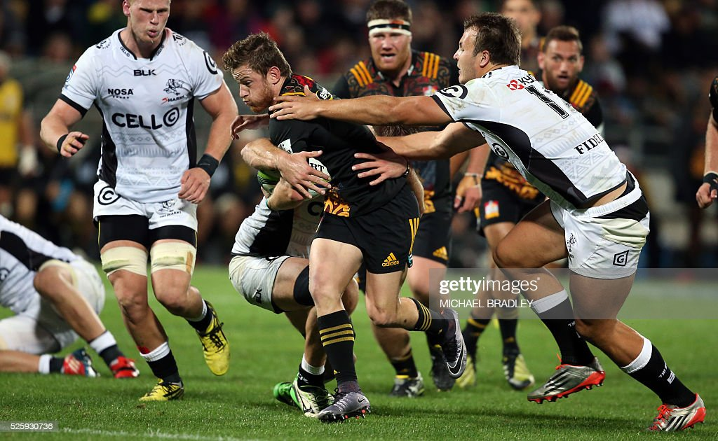 Chiefs' Brad Weber is tackled by the defence during the Super Rugby match between the Waikato Chiefs of New Zealand and Coastal Sharks of South Africa at Yarrow Stadium in New Plymouth on April 29, 2016 / AFP / MICHAEL