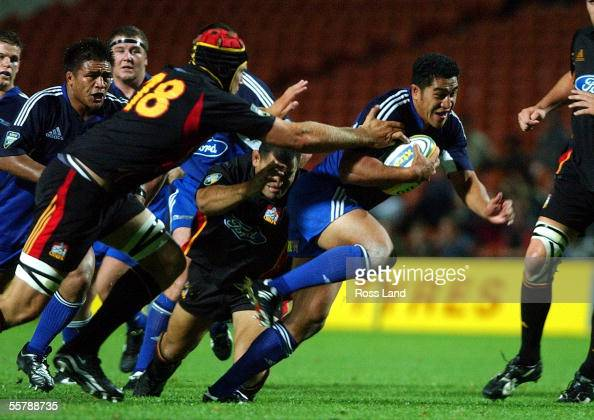 Chiefs Chrestin Davis tries to stop Mils Muliaina during the Super12 match won 3027 by the Blues at at Waikato Stadium Hamilton Friday