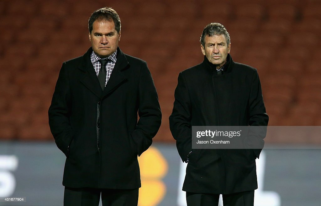 Chiefs head coach Dave Rennie (L) and assistant coach Wayne Smith watch their team warm-up before the round 18 Super Rugby match between the Chiefs and the Hurricanes at Waikato Stadium on July 4, 2014 in Hamilton, New Zealand.