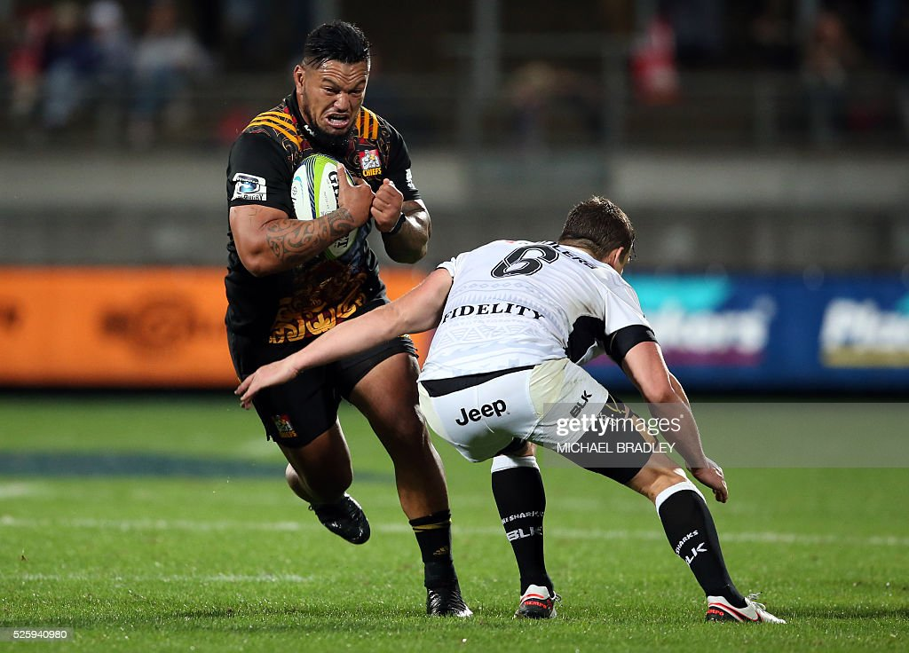 Chiefs' Hika Elliot (L) is tackled by the Sharks' Keegan Daniel (R) during the Super Rugby match between the Waikato Chiefs of New Zealand and Coastal Sharks of South Africa at Yarrow Stadium in New Plymouth on April 29, 2016 / AFP / MICHAEL