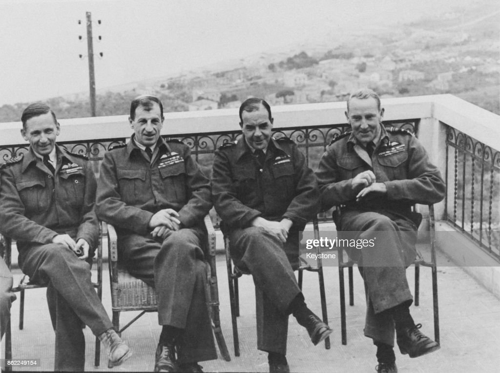 RAF chiefs meet for a conference in Italy during World War II, late 1943. From left to right, Air Chief Marshal Sir Arthur Tedder, Air Officer Commanding-in-Chief, Mediterranean Air Command, Air Chief Marshal Sir Charles Portal, Chief of the Air Staff, Air Vice Marshal Harry Broadhurst, Air Officer Commanding Desert Air Force, and Air Marshal Sir Arthur Coningham, Air Officer Commanding North African Tactical Air Force.