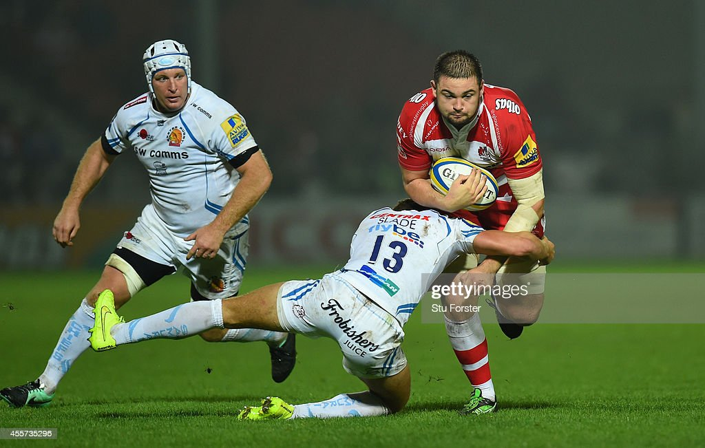 Chiefs player Henry Slade attempts to tackle Elliott Stooke of Gloucester during the Aviva Premiership match between Gloucester Rugby and Exeter...