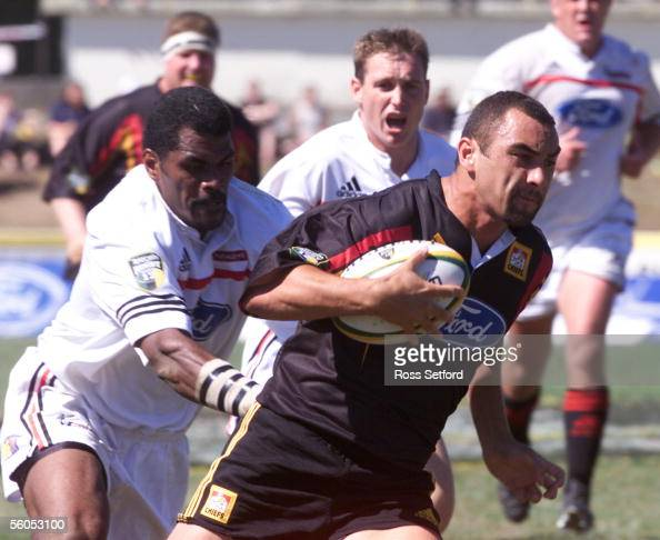 Chiefs Roger Randle leaves behind the Crusaders Marika Vunibaka in their opening Telecom Super 12 match at Rugby Park Hamilton Sunday The Crusaders...