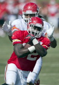 Chiefs running back Cyrus Gray runs past the defense of Chiefs defensive end Austen Lane following Kansas City's summer training camp at Missouri...