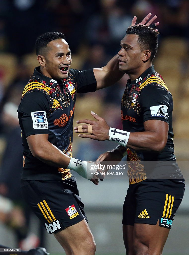 Chiefs' Seta Tamanivalu (R) celebrates with teammate Anton Lienert-Brown (L) during the Super Rugby match between the Waikato Chiefs of New Zealand and Coastal Sharks of South Africa at Yarrow Stadium in New Plymouth on April 29, 2016 / AFP / MICHAEL
