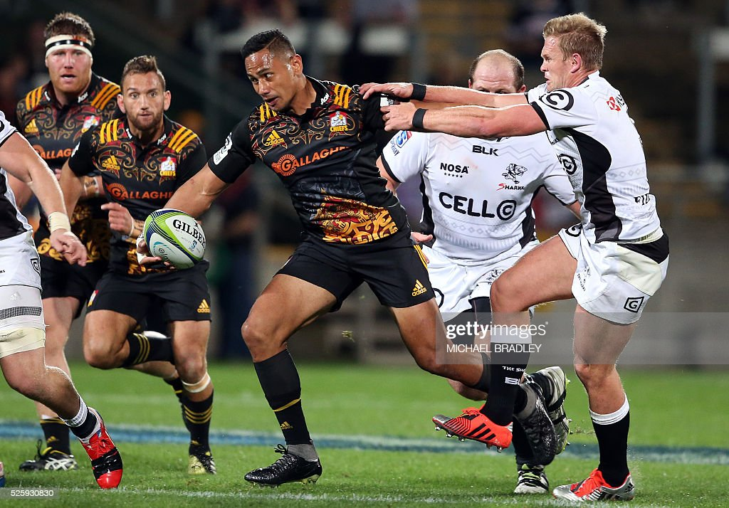 Chiefs' Toni Pulu (L) is tackled by the Sharks' Daniel du Preez (R) during the Super Rugby match between the Waikato Chiefs of New Zealand and Coastal Sharks of South Africa at Yarrow Stadium in New Plymouth on April 29, 2016 / AFP / MICHAEL