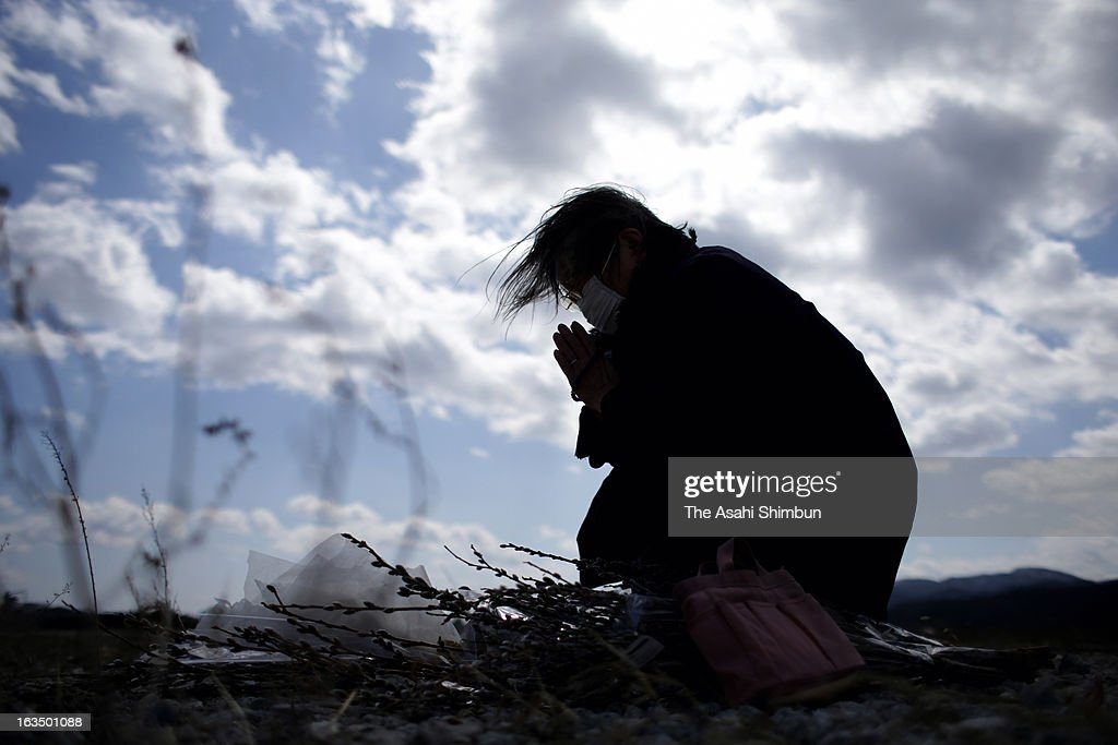 Chieko Suzuki, 74, prays for the vctims at the place her house used to stand, on March 11, 2013 in Rikuzentakata, Iwate, Japan. On March 11, Japan marks second anniversary of the Magnitude 9.0 earthquake and subsequent tsunami, that claimed more than 18,000 lives.